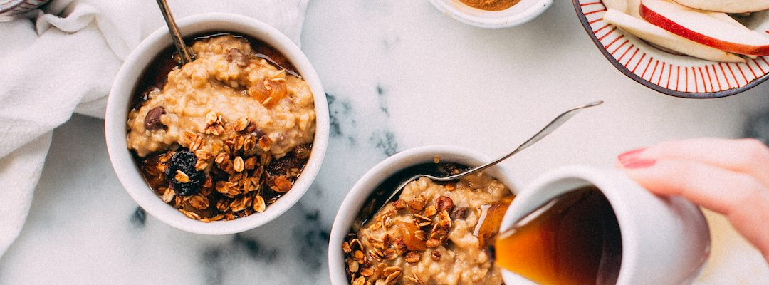 bowls of oatmeal with apples