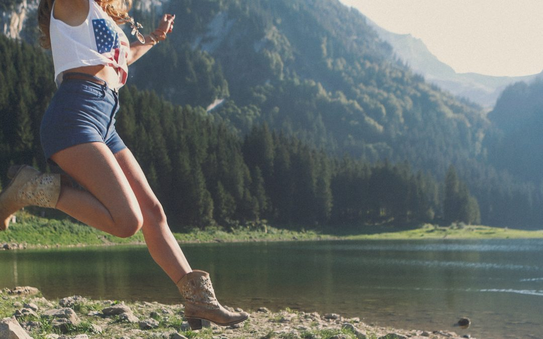 Blogger celebrating losing weight by leaping outdoors
